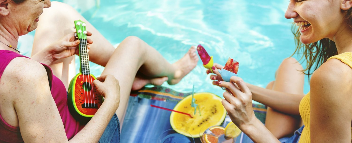 Girls relaxing by the swimming pool during fall on Grand Cayman