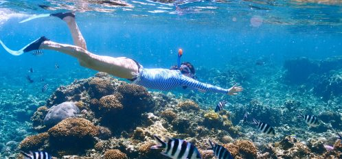girl enjoying the best snorkeling in the Cayman Islands