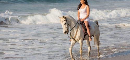 Girl enjoying Grand Cayman horseback riding