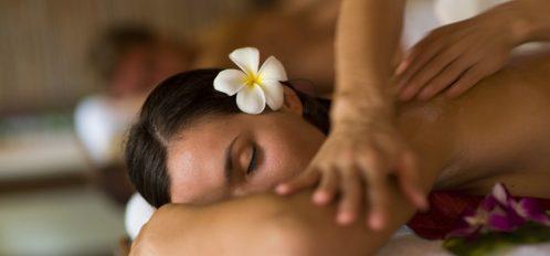 woman enjoying Grand Cayman spa treatment