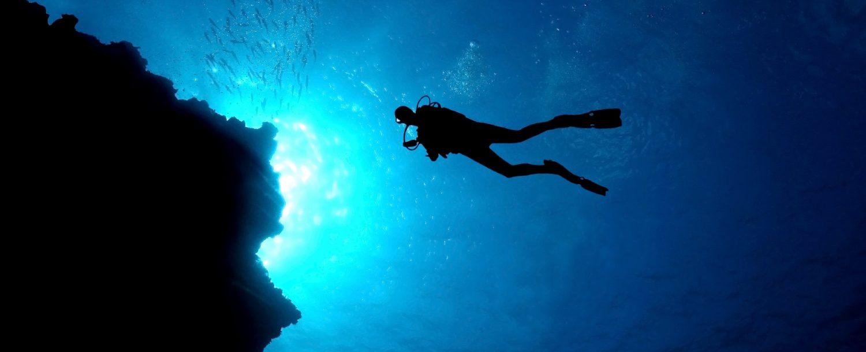 man enjoying shore diving in grand cayman