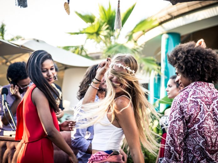 friends dancing in lounge at the kaaboo cayman music festival