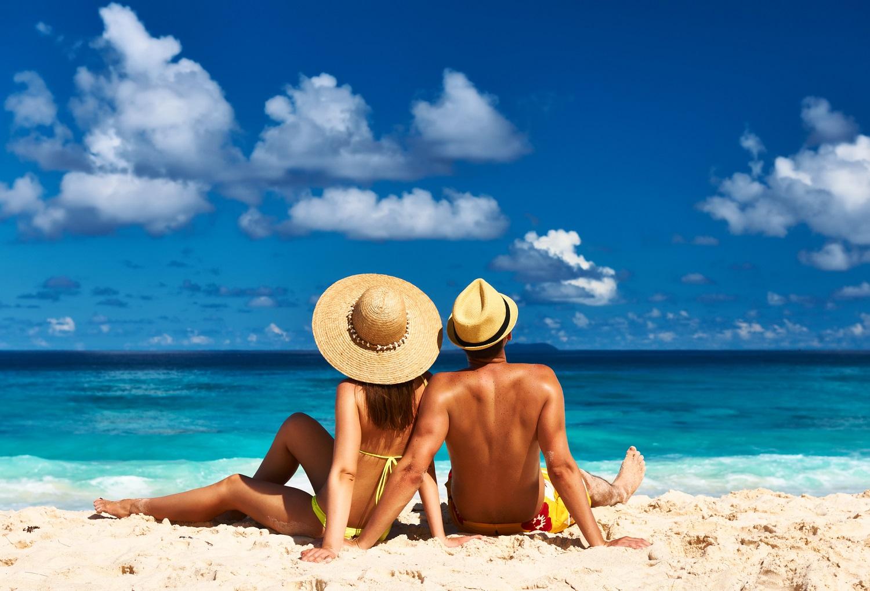 Couple on a tropical beach at Grand Cayman